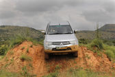 Silver Toyota Triton DHD crossing obstacle — Stock Photo