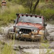������, ������: Crush Orange Jeep Rubicon crossing muddy pond