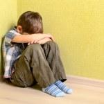 Little child boy wall corner punishment sitting — Stock Photo