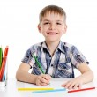 Cute boy drawing with colourful pencils — Stock Photo