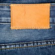 Stock Photo: Leather jeans label sewed on jeans
