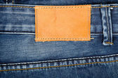 Leather jeans label sewed on jeans — Stock Photo