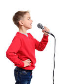 Little boy with microphone sings a song — Stock Photo