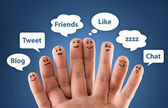Happy group of finger smileys with social chat sign and speech b — Stock Photo