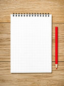 A white note book with lots of room for your text or image and a — Stock Photo