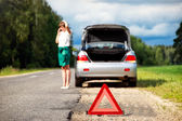 Woman with telephone near the broken car — Stock Photo