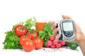 Diabetes concept glucometer and healthy food — Stock Photo