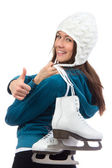 Woman with ice skates thumb up — Stock Photo