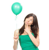 Girl with green balloon as a present for birthday party — Stock Photo