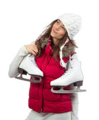 Young woman holding ice skates for winter ice skating — Stockfoto
