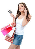 Happy Beautiful woman with shopping bags and credit gift card — Stock Photo