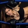 Sports Boxing Woman in black box gloves in fitness gym — Stock Photo #20758627
