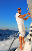Young Sailor relaxing happily on the vacation sailboat yach — Stock Photo