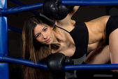 Sports Boxing Woman in black box gloves in fitness gym — Stock Photo