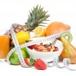 Diet weight loss breakfast concept with tape measure - Stock Photo