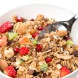 Muesli cereals bowl and spoon with almond, pine nuts — Stockfoto #22589561