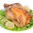 Garnished roasted chicken on a plate — Stock Photo