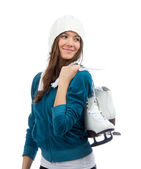Woman holding ice skates for winter ice skating sport activity — Stock Photo