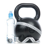 Big black fitness weight with tape measure — Stock Photo