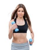 Jonge sport vrouw uitvoeren of joggen met gewichten — Stockfoto