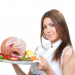 Woman holding plate in hands with turkey meat ham decorated lett — Stock Photo #32151723