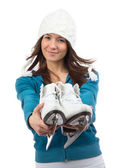 Young woman showing ice skates for winter ice skating — Stock Photo