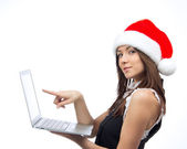 Christmas woman with laptop pointing monitor display — Stock Photo