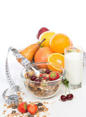 Muesli cereals bowl and spoon with tape measure centimetr raisin — Stock Photo