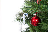 Part of decorated Christmas tree with patchwork ornament ball — Stock Photo