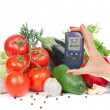Diabetes concept glucose meter in hand and healthy organic food — Stock Photo #38363063