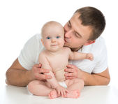 Happy family young father and child baby girl kissing and huggin — Stock Photo