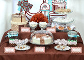 Fancy set table with sweets candies, cake, marshmallows, zephyr, — Stock Photo