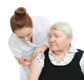 Doctor making senior woman patient an arm subcutaneous insulin — Stock Photo