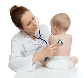 Nurse auscultating child baby patient spine with stethoscope — Stock Photo