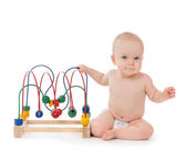 Kindergarten child baby toddler sitting and playing wooden educa — Stock Photo