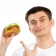 Young man with tasty fast food unhealthy burger sandwich — Stock Photo #42155397