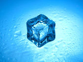 One frozen ice cube with clear water drops  — Stock Photo