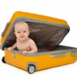 Happy infant baby toddler sitting in yellow plastic travel suitc — Stock Photo