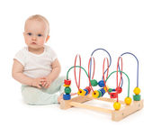 Happy child baby toddler sitting and playing wooden educational  — Stock Photo