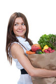 Young woman holding shopping bag with groceries vegetables  — Stock Photo