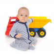 Child baby boy toddler happy sitting with big toy car truck — Zdjęcie stockowe