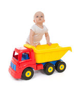 Infant child baby boy toddler with big toy car truck — Stock Photo