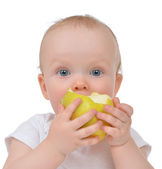 Infant child baby girl eating apple closeup — Stok fotoğraf