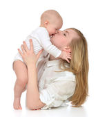 Mother kissing and laughing infant child baby kid girl — Stock Photo
