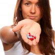 Doctor offering pills capsules red and blue to the patient — Stock Photo #4846726