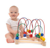 Infant child baby toddler standing and playing wooden educationa — Stock Photo