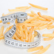 French fries chips meal with tape measure — Stock Photo #49239927
