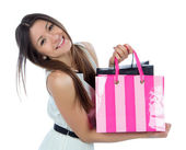 Pretty young woman with shopping bags after successful shopping  — Stock Photo