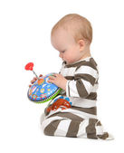 Infant child baby boy toddler playing with whirligig toy  — Stock Photo