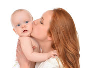 Kissing in her arms new born infant child baby kid girl — Stock Photo